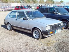 https://flic.kr/p/7YAdBt | 90 Toyota  Starlet GL (1983) | Toyota Starlet (1978-84) Engines 993, 1166, 1290 cc S4 OHV Production 950,691 Registration Number EEL 231 Y TOYOTA SET www.flickr.com/photos/45676495@N05/8258149874/in/set-7215... Performance 1.3 ltr 83 mph 0-60 14.9 seconds Wheels wider and non standard Rear wheel drive in spite of appearance, the 1.3 ltr arrived in the UK in 1982 most with five speed gearboxes. Sold as the Publica in some other markets Shot at the Save Donington…
