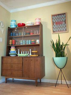 Mid century display cabinet. Vintage Pyrex. Mid century bullet planter.