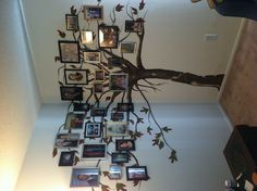 The family tree I had painted on my wall. Just finished hanging the pictures