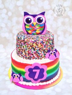 """Rainbow Owl Cake 8"""" & 6"""" cherry cake with cherry pie filling and vanilla buttercream. Fondant owls and number. Buttercream stripe technique to bottom tier. Sprinkles to top tier. Thanks for looking :) ~April"""