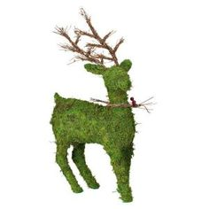 A reindeer covered in green moss! Would be adorable fas a #holiday centerpiece in your dining room or on a #mantel -- #christmas #tabletop #centerpiece #tablesetting