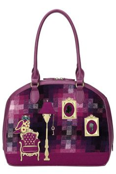 This bag's unique design is a real head turner. The front of the Vendula Downton Shoulder Bag features a stunning applique vintage chair with gold and pink tartan detail. The purple one has a front and back in woolen purple and pink tartan design with matching faux leather base and sides. Pink tartan with a deep magenta woolen trim as the background. The purple version has a full woolen fabric back. Gold embroidery, a cute little owl with big blue eyes and a golden chain and key. On the back…