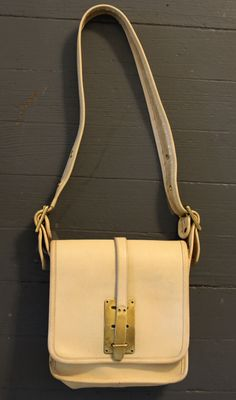 Rare COACH 1960s or 70s Pre-creed Bag / Purse with Solid Brass Closure in Bone / Ivory by CashinCarry on Etsy https://www.etsy.com/listing/255570017/rare-coach-1960s-or-70s-pre-creed-bag