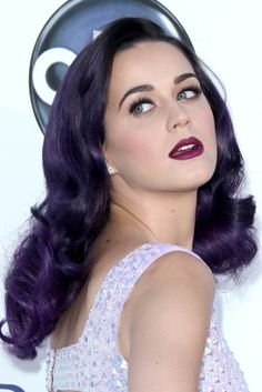 Take a page from Katy Perry's book and coordinate your lip color with what you're wearing. Here the whimsical pop star has paired a violet-inspired lipstick with purple hair and lavender-toned gown.