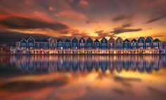 """Dutch architecture in Houten, Holland. The houses are also called """"The Rainbow Houses"""" because of their vibrant colors."""