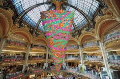 """Galeries Lafayette innovate with a Christmas Tree upside down!, with its point to the ground, and at the tree base a Christmas Store will be open and each hour you will be invited to a """"Sound and Light"""" show from a height of 25 metres!, pinned by Ton van der Veer"""