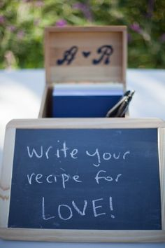 Guest book! this was totally my idea!! eric and i both love to cook/bake so its personal to us and so much better than just signing a book that you will never go back and look at, didnt know that other people did this too as their guest book lol
