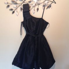 Beautiful Black party dress This Black party dress is taffeta like material one fancy shoulder, back zipper, sash Steps Dresses