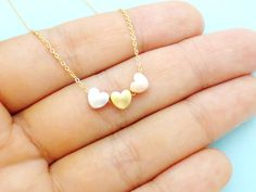 Triple color gold, silver, pink gold(rose gold) hearts on gold/ silver/ pink gold(rose gold) chain and lobster clasp Lovely piece for everyday ✰ Color: triple color hearts on gold/ silver/ pink gold(rose gold) chain ✰ Heart pendant size: 8mm each ✰ 15-18 chain length ✰ Strong and sturdy