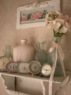 shelf displaying  rhinestone clocks - you can find this rose yard-long picture and more at www.hendersonmemories.com