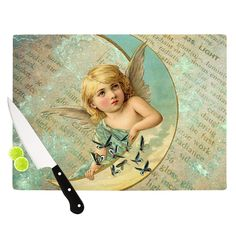 "Suzanne Carter ""Angel"" Teal Yellow Cutting Board from KESS InHouse"