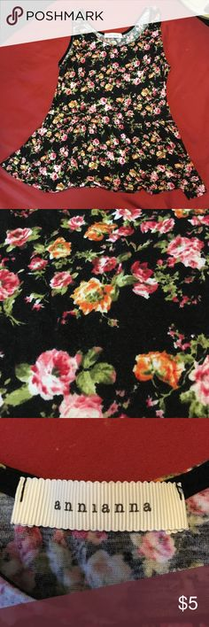 Cute black with floral design Black top with roses all around. Loose fitting. Used. No size tag on. Fits small Tops