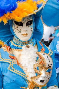 Blue and Orange - a very interesting colour scheme. and I like the half mask too. Most unusual.