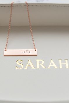 This horizontal rectangle tag necklace in rose gold is  a great gift for yourself or someone you love. The contemporary design is simplistic and dainty and will look great with almost any outfit. Each tag can be carefully hand stamped to order. Personalize with a single, double or triple initial monogram. Pair with a personalized jewelry tray.