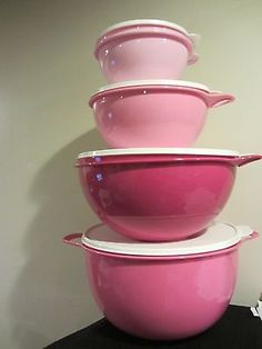 NEW Tupperware Thatsa Mixing Bowls 4 PC SET Pink with White seals. LOVE!!!!!!!! I have the red but I love this color!!!!