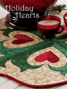 Holiday Hearts is a great project for Valentine's Day! Create this table topper with fabrics of your choice. Use reds and whites for something specific for Valentine's Day or keep it as is for a year round affair!