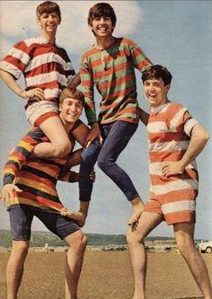 Beatles on the beach! LOL. Paul's onesie.