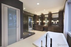 This bathroom features a glass-enclosed shower, double vanity, and glossy soaking tub.  Source: http://www.zillow.com/digs/Home-Stratosphere-boards/Luxury-Bathrooms/