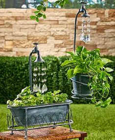 A Water Drop Planter will be as much a sensation as the lovely plants growing in it. It features plastic beads coming from the faucet that look like water drops