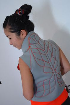 The 'Massage me' concept is a wearable massage interface that turns a video game player's excess energy into a back massage for your partner or loved ones. Playing Massage me requires two people, one who wears the jacket to receive the massage and one who massages the person wearing the jacket.