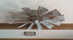 Attached an old windmill to my ceiling fan.  Love it!!!