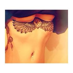 Underboob tattoo wings