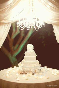 Glamorous tented wedding cake display with a golden chandelier #wedding #weddingcake #blacktie #cake #gold