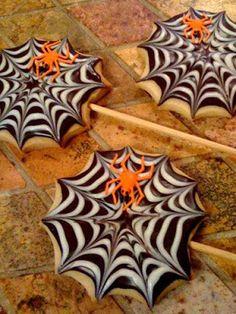CHOCOLATE SPIDERS - 1 (12oz) bag semi-sweet chocolate chips 5-1/4 oz. mini marshmallows (half a bag) waxed paper th...