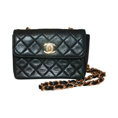 Chanel Black Lambskin Quilted Extra Mini Flap Handbag GHW - 1991 | From a collection of rare vintage handbags and purses at https://www.1stdibs.com/fashion/accessories/handbags-purses/