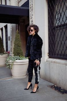Your Adidas sweat pants with a fake fur coat and high heels. You look fabulous!