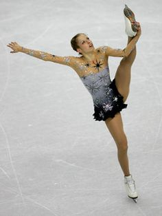 """Italian Carolina Kostner wore a snowflake-covered outfit in 2006 that employed the sheer-illusion look that Wang likes for the ice. """"She has a more womanly, mature style but this outfit brings her youth and whimsy,"""" Wang says."""