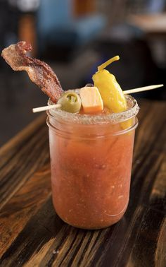 The Red Headed Stranger - bacon infused Tito's vodka, bloody mary mix, bacon, cheddar cheese, jalapeno stuffed olive, pepperocini... there is nothing left to say but, IT's A MEAL!