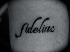 """Fidelius has Latin roots meaning loyalty, but it is actually the secrecy charm from Harry Potter...I got it done at Body Language in Ringwood, Victoria (Australia)."" I like the idea of getting the actual latin word for loyalty (Fidelitas) tatted on me..since I think that is my greatest value."
