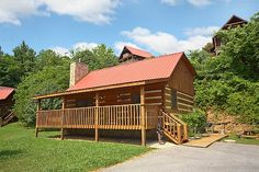 That Away cabin rental near Pigeon Forge, TN. This delightful two-bedroom cabin is great for a small family getaway. This comfortable cabin features a fishing pond right next it and is pet friendly! Relax in the serene mountain setting in the roomy hot tub or take advantage of the Jacuzzi tub in the bathroom. At the end of an exciting day gather around the fireplace and watch a movie or relax on the covered deck under the stars.