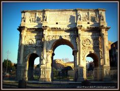 """Stand outside the beautiful Arch of Constantine in Rome. Find out more at """"Down the Wrabbit Hole - The Travel Bucket List"""". Click the image for the blog post."""