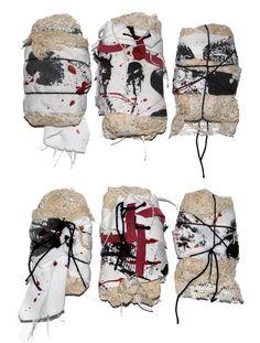 Caroline Sax - Fabric bundles with screen printed cotton and twine.