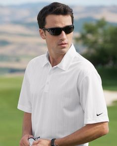 What about this super classic Nike Golf 371742 Dri-FIT Drop Needle Polo for Men??    1. Self-fabric collar three-button placket open hem sleeves and side vents.  2. The contrast Swoosh design trademark is embroidered on the left sleeve.  3 Made of 4.7-ounce 100% polyester Dri-FIT fabric.