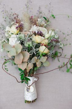 Eucalyptus and wildflowers make for a beautifully boho wedding bouquet.