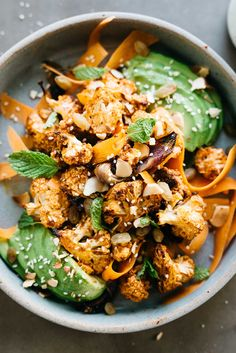 Nina's Moroccan Harissa Salad with Harissa Roasted Cauliflower, Carrot Ribbons, Onions, Avocado, Raisins, Almonds & Orange Tahini Dressing Sauce | dolly and oatmeal