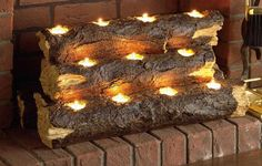 Southern Enterprise Burning Log Fireplace Candelabra - Re-create the rustic charm of a wood fire with the clever Southern Enterprise Burning Log Fireplace Candelabra . This handcrafted resin sculpture resembles. Unused Fireplace, Faux Fireplace, Fireplace Inserts, Fireplace Ideas, Decorative Fireplace, Fireplace Filler, Library Fireplace, Basement Fireplace, Bedroom Fireplace