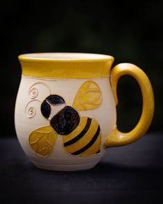 Bright and cheerful this ceramic bee mug will add to anyone's morning coffee. Unique design and hand glazed it will make a fabulous present for someone. Yellow glaze adorns rim, handle and bee; contrasting black finishes the cute insect Bee Creative, I Love Bees, Tile Crafts, Save The Bees, Bees Knees, Mug Cup, Morning Coffee, Cup And Saucer, Crock