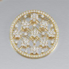 DIAMOND 'SNOWFLAKE' BROOCH/PENDANT, VAN CLEEF & ARPELS, CIRCA 1993 Of open work annular design to a lattice work centre interspersed with single and clusters of brilliant-cut diamonds, framed by a line of similarly cut stones, signed VCA and numbered, French assay and maker's marks, inscribed 'Joyeaux Anniversaire 1993', brooch fitting deficient, together with a flattened fancy link chain, length approximately 495mm