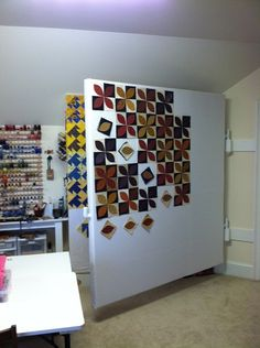 Hinged design wall. I ran out of wall space, so I may have to add more walls! I never have just one quilt going, usually 4 or 5.
