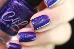 CbL February 2017 Polish of the Month - The PotM for February 2017 is called Siren's Song. This polish is a blurple linear holographic with color shifting glitters that shift from green to red to gold. This polish looks different from every angle. Photo courtesy of @ressa_d on Instagram.