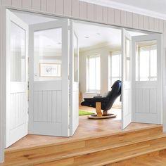 Thrufold Suffolk 3+2 Folding Door - Clear Glass - White Primed - Lifestyle Image.    #glazedfoldingdoors #foldingdoors