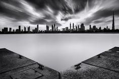 "Silky... by Charlie Joe on 500px ""Better on Black. Burj Khalifa and Dubai cityscape during cloudy sunrise. Lee Big stopper for 180s. """
