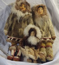 Vintage Inuit Eskimo Doll, with fur, wood. Very collectible.  Wood faces.    The hand sewn face and body has amazing details, revealing clothes