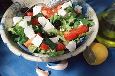This classic Greek salad is dressed with a lemon, garlic, and olive oil dressing. It's an excellent salad to serve as a side dish or light lunch.