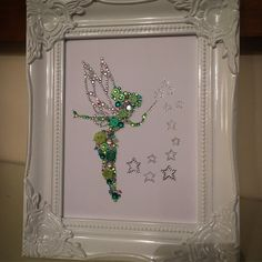 Tinkerbell decoration, tinkerbell button and Swarovski crystal framed art. Tinkerbell is created using high quality buttons, rhinestones and genuine Swarovski crystals. Im happy to adapt colours. Please message if youd like to enquire. Perfect gift for all occasions. Available in a range of sizes. Happy to discuss other character frames.
