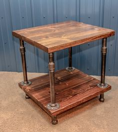 Our unique Industrial End Table is handcrafted from wood (1 1/2- 2 thick). Shown stained in Special Walnut stain and protected with two coats polyurethane, satin finish( unless request otherwise). Mounted to black galvanized 1 inch pipes and flanges.  This table measures: *Size can be customized* 24 inches wide 24 inches deep 25 inches tall weight-53lbs  **Shown using black 1 inch galvanized pipes and flanges (looks more like a dark grey, gunmetal color)  *Size and stain can be customized…